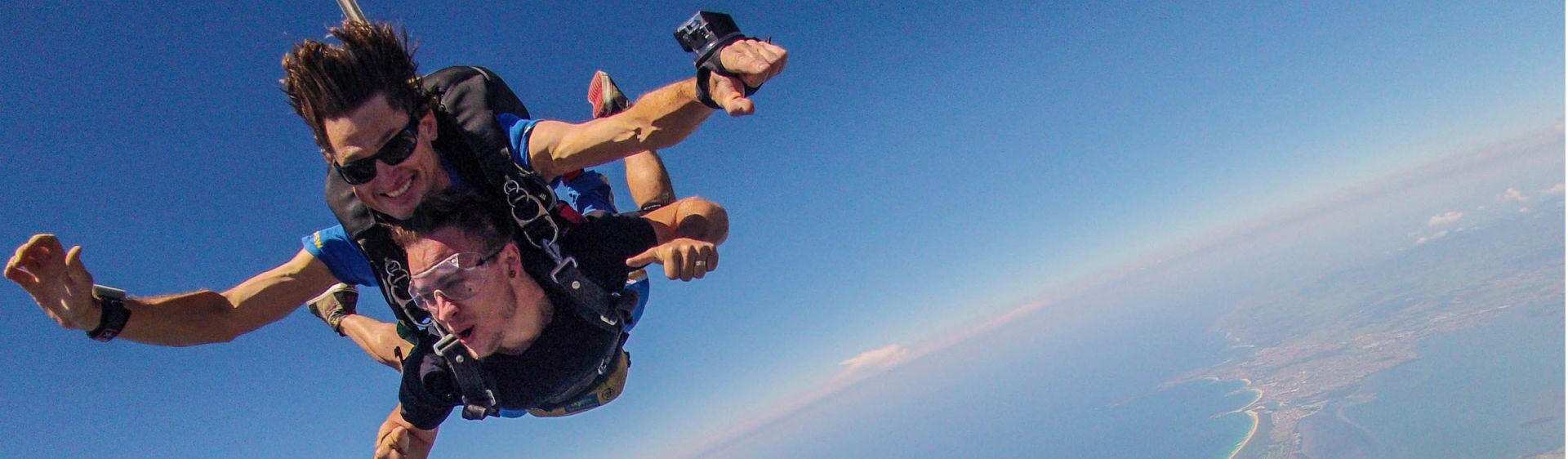 Chief Funster Andrew Smith skydiving with Skydive The Beach over Wollongong
