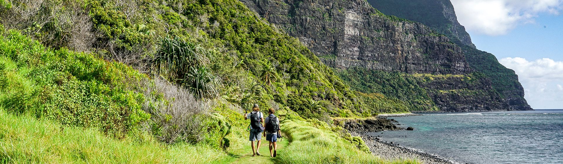 Friends walking on waterside trail on Lord Howe Island