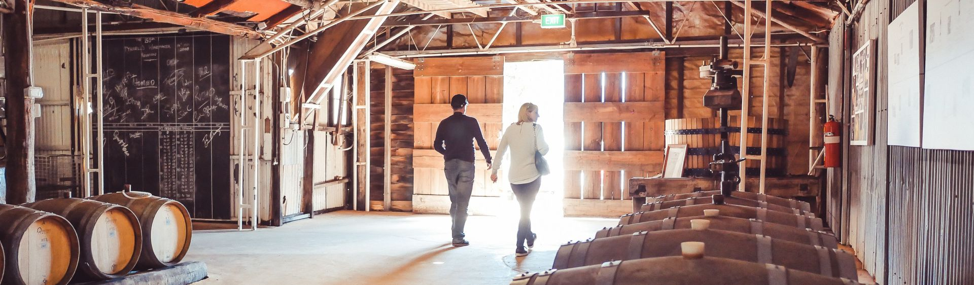Couple touring inside Tyrrell's old winery, Pokolbin, Hunter Valley