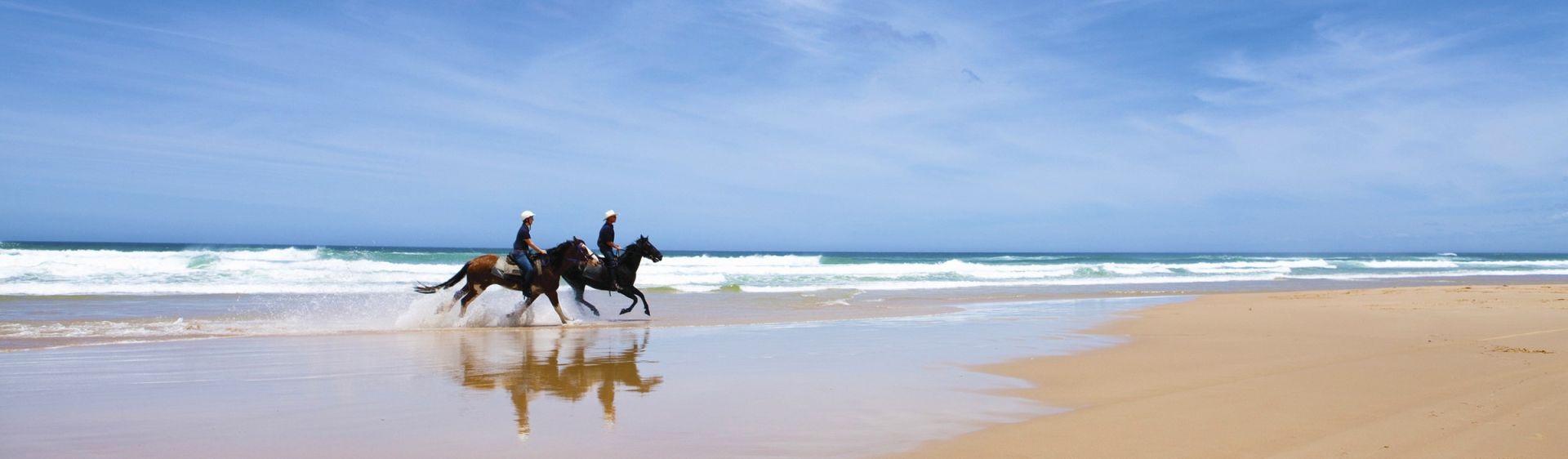 Horseriding along the beach in Worimi Conservation Lands, Port Stephens