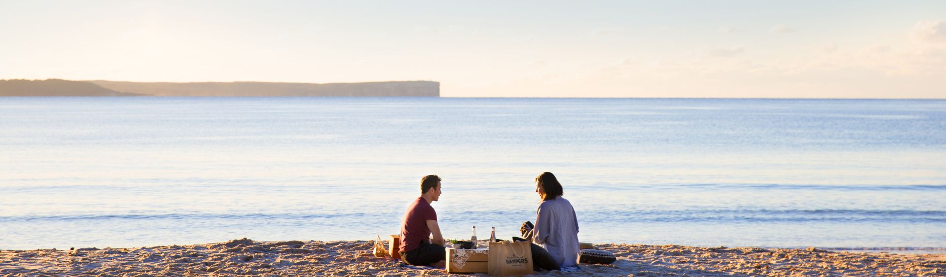 Couple enjoying a picnic at Blenheim Beach in Shoalhaven, NSW South Coast