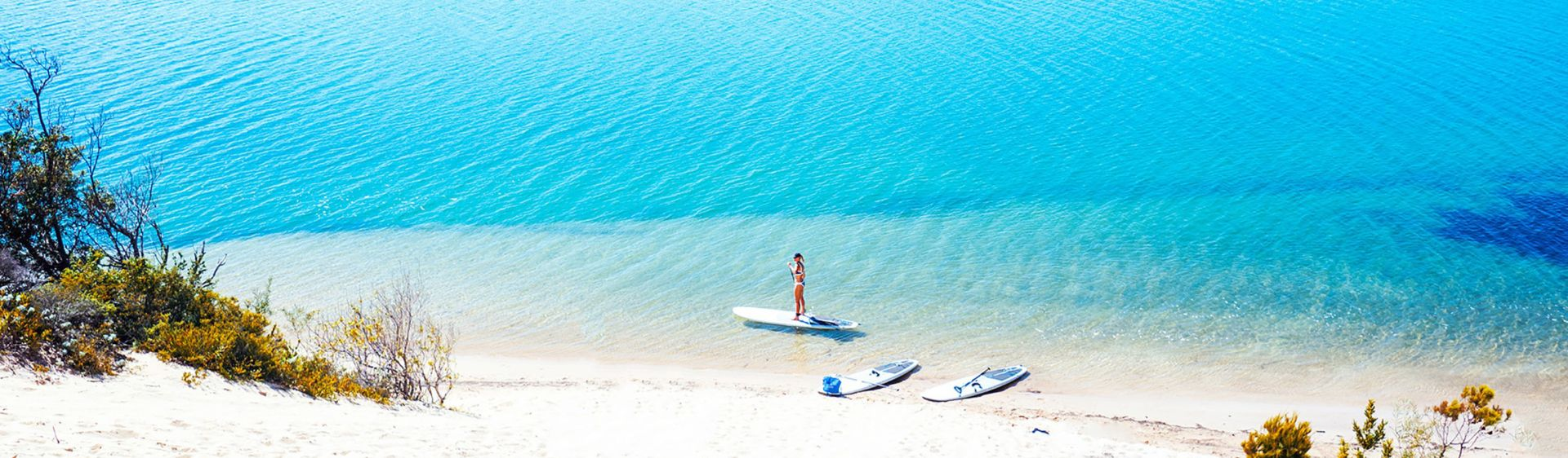 Stand-up paddleboarding on aqua blue waters, Wooli Wooli River