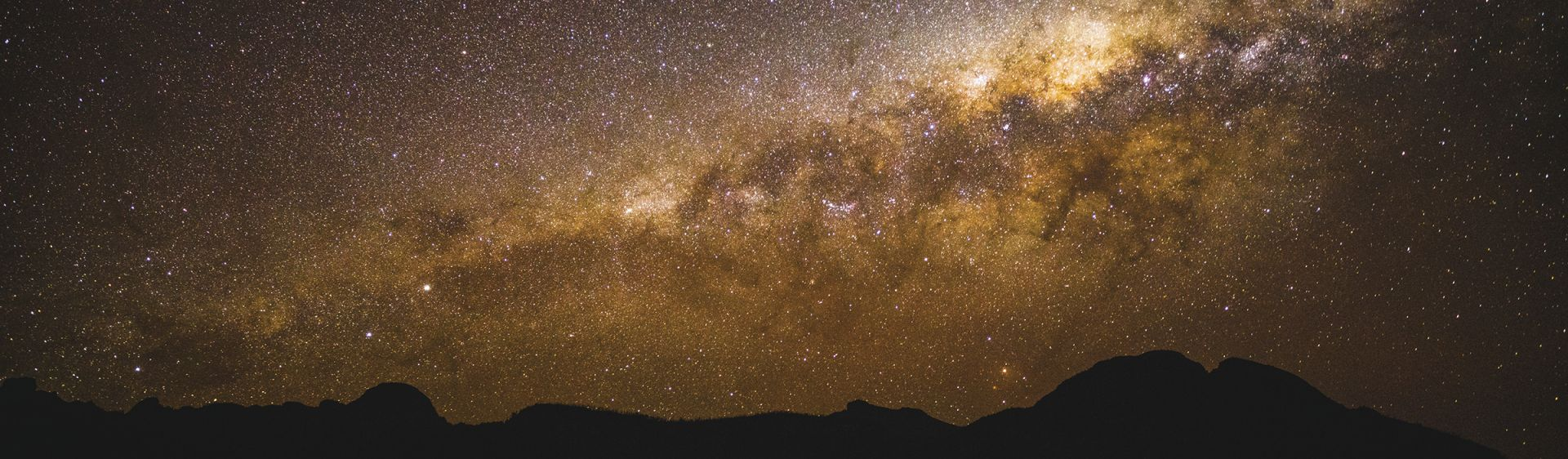 The starry Milky Way above the volcanic silhouette, Warrumbungles