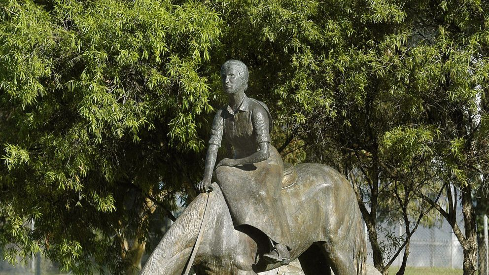 A memorial statue of Dorothea Mackellar on a horse, in Gunnedah