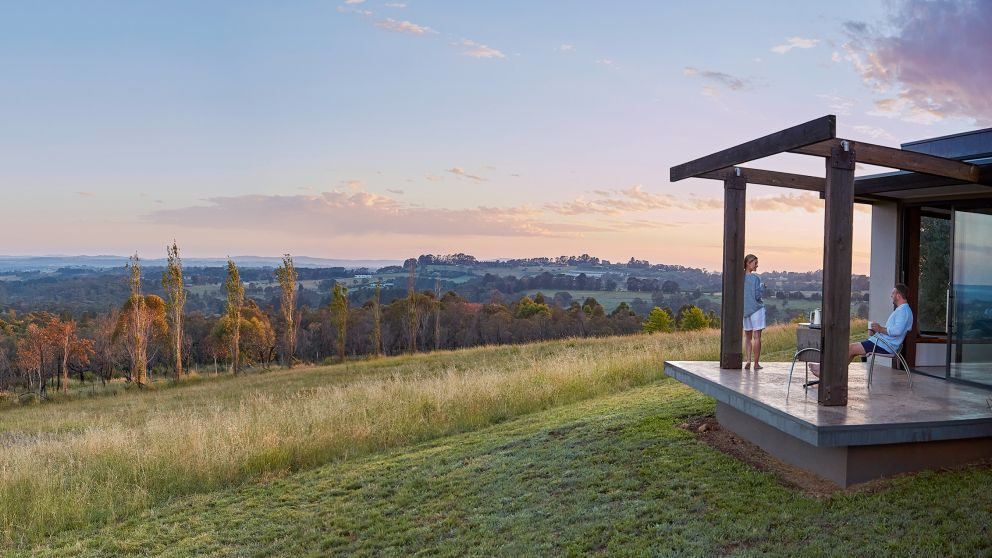 Couple enjoying the views in their country accommodation in Orange, NSW