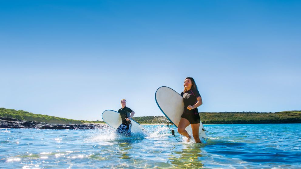 Surfers at Killalea Beach ('The Farm'), Shell Cove
