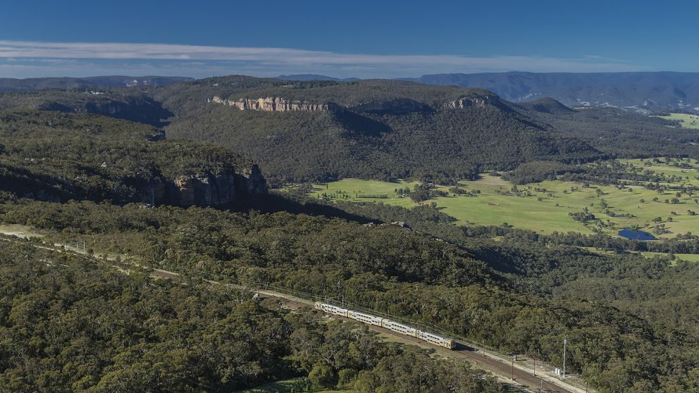 Train passing through Mount Victoria with scenic views of the World-Heritage listed Blue Mountains National Park