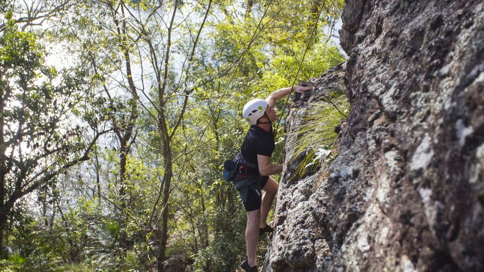 Man enjoying a rock climbing experience with Outdoor Raw in the Shoalhaven region of NSW