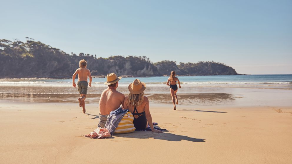 Family beach fun at McKenzies Beach in Batemans Bay