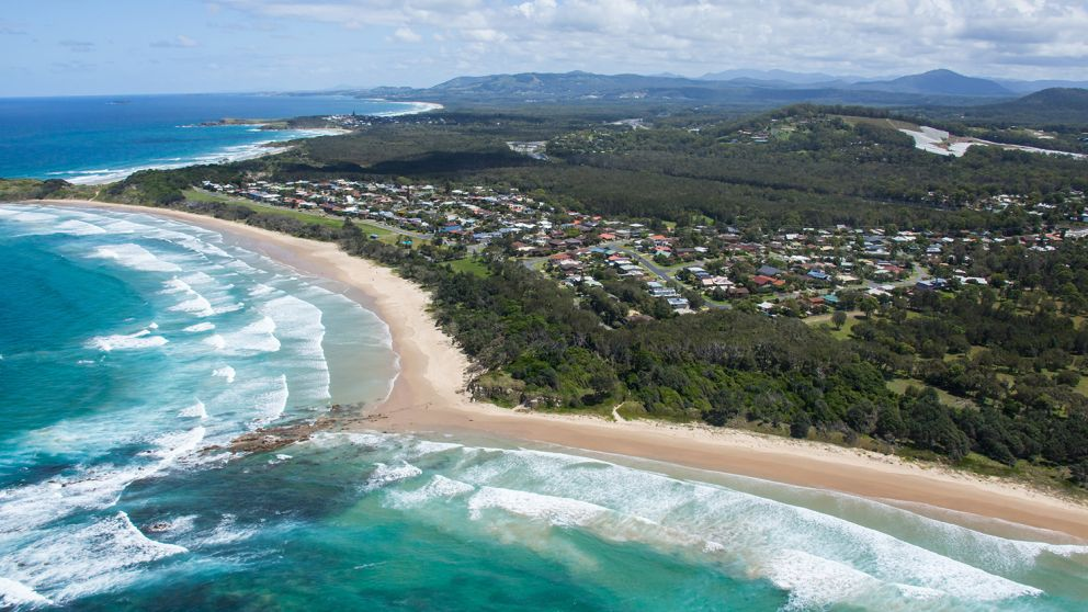 Coastal aerial of Dammerels Head and the township of Sandy Beach, North Coast