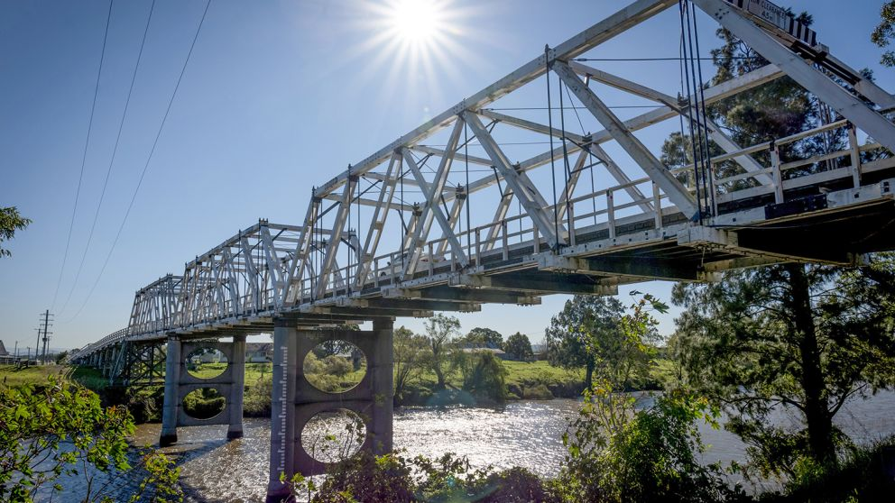 The heritage-listed Morpeth Bridge spanning across he Hunter River, Morpeth