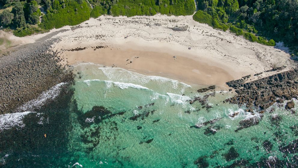Coastal aerial of Pebbly Beach and Bicentennial Walk in Forster, North Coast NSW