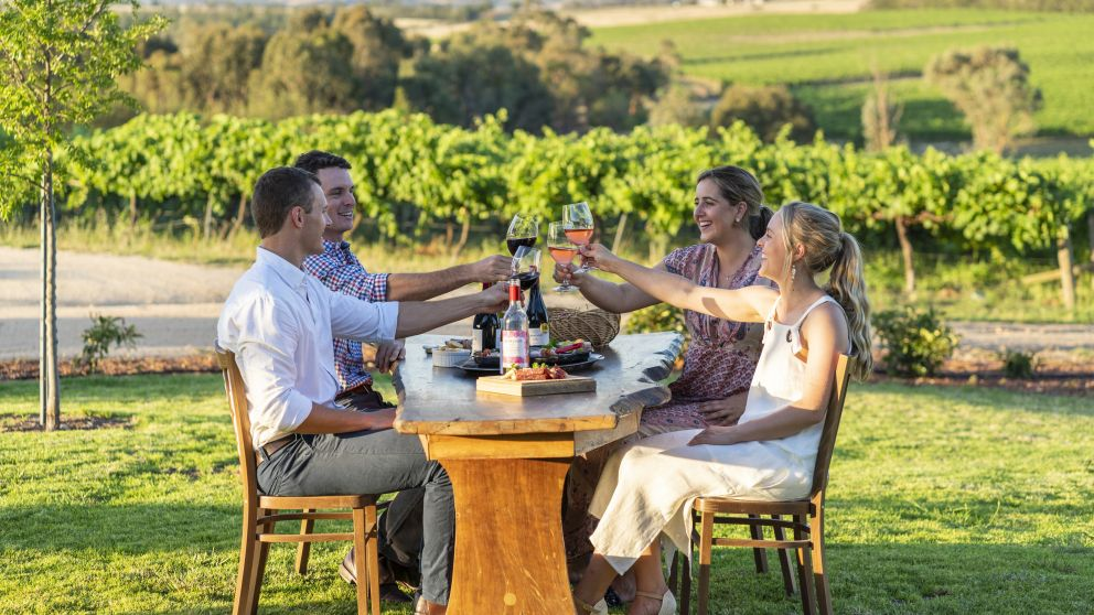 Couples enjoying food and wine at Grove Estate Wines in Young, Country NSW
