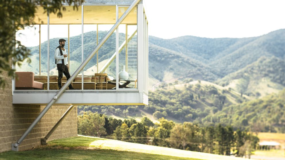Man enjoying a glass of wine and the scenic country views from Logan Wines in Mudgee