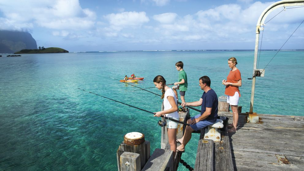 Family enjoying a day of fishing from the Lord Howe Island Wharf