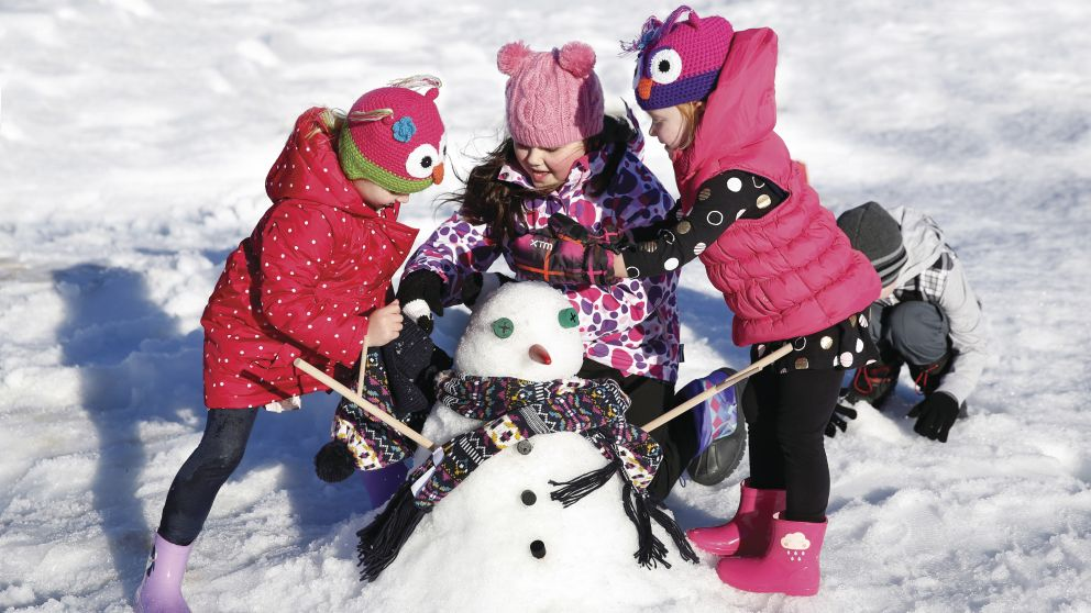 Children building snowmen at Snowtime in the Gardens event in The Hunter Valley Gardens