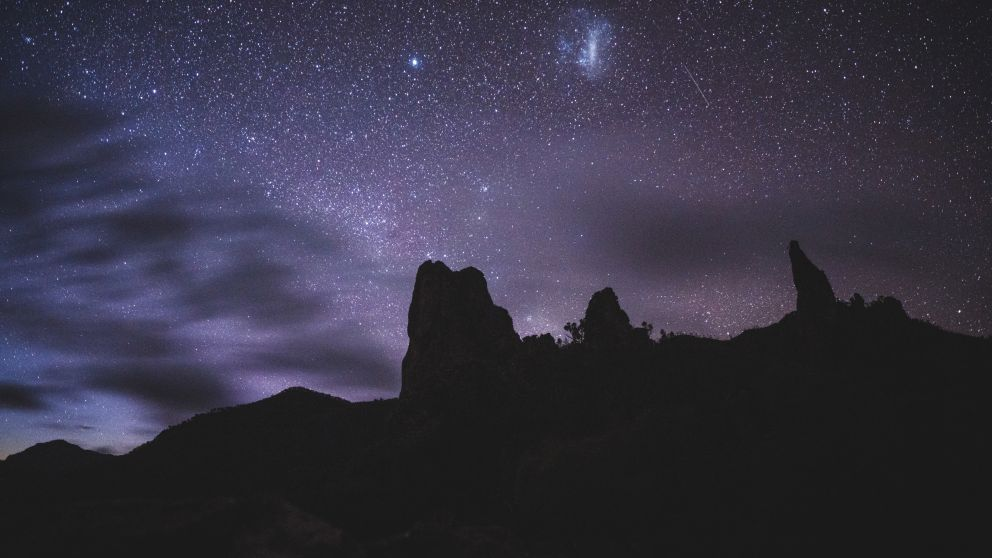 Bright stars above the Breadknife rock silhouette, Warrumbungle National Park