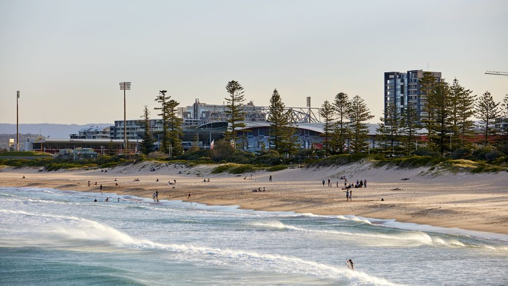 People enjoying the sand and surf at Main Beach, Wollongong