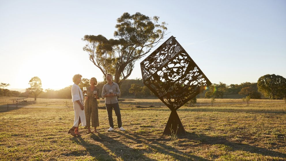 Couple enjoying a tour of the Sculptures in the Gardens with Kay Norton-Knight of Rosby Wines & Guesthouse, Eurunderee