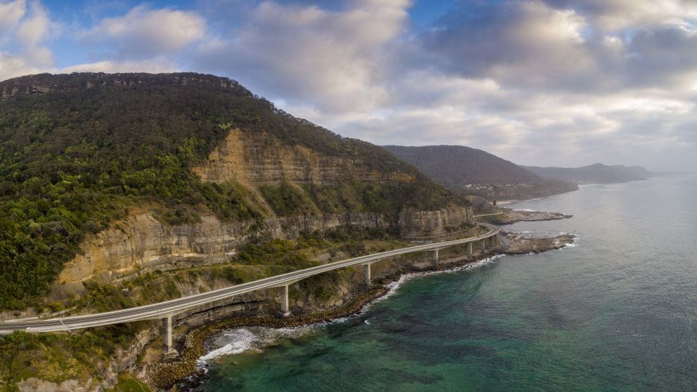 Aerial overlooking the scenic Sea Cliff Bridge in Clifton