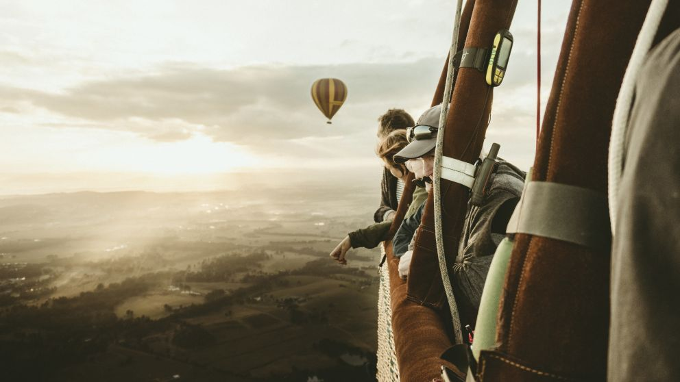 People enjoying a hot air balloon ride over the Hunter Valley