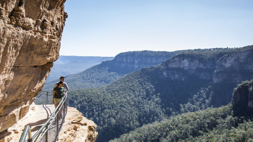 Couple enjoying a walk along the Wentworth Falls Track in the Blue Mountains National Park