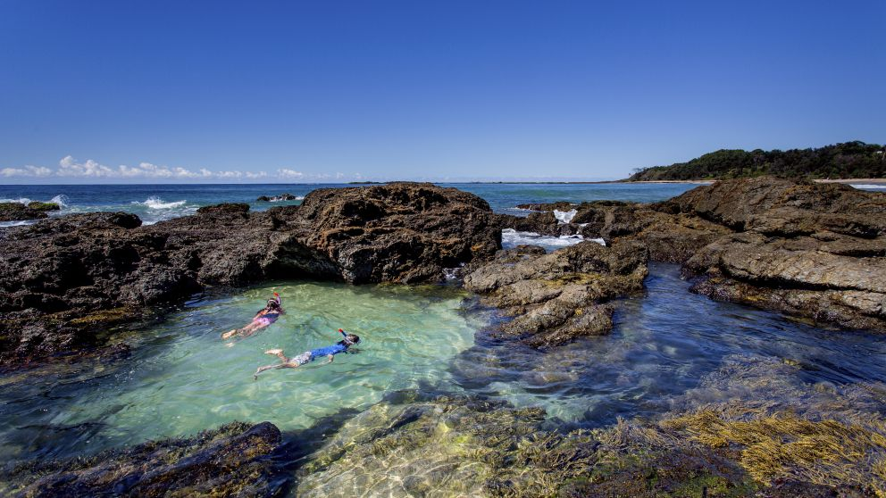 Children snorkelling in a rock pool near Wooli, Clarence Valley, North Coast