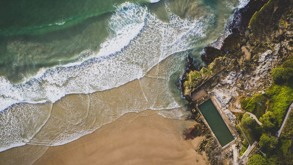 Scenic aerial overlooking Yamba Main Beach and Yamba Ocean Pool, Clarence Valley