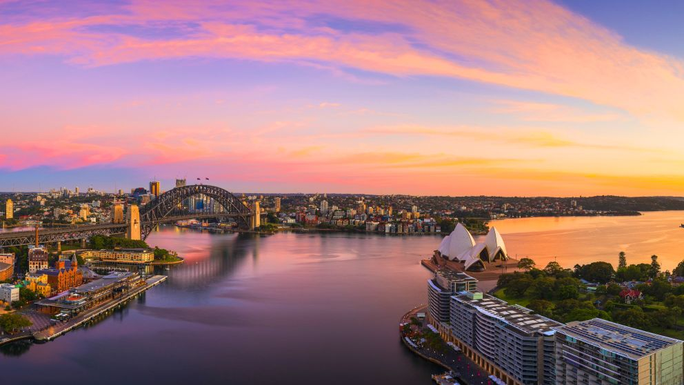Sun rising over Sydney Harbour and Circular Quay, Sydney.