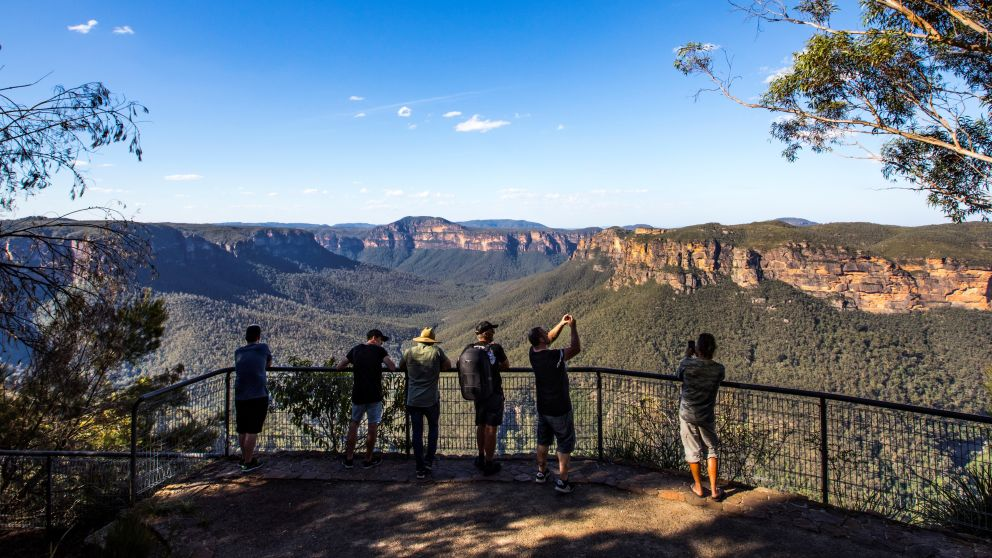 Tourists enjoying the views across the Grose Valley at Evans Lookout in Blackheath, Katoomba Area
