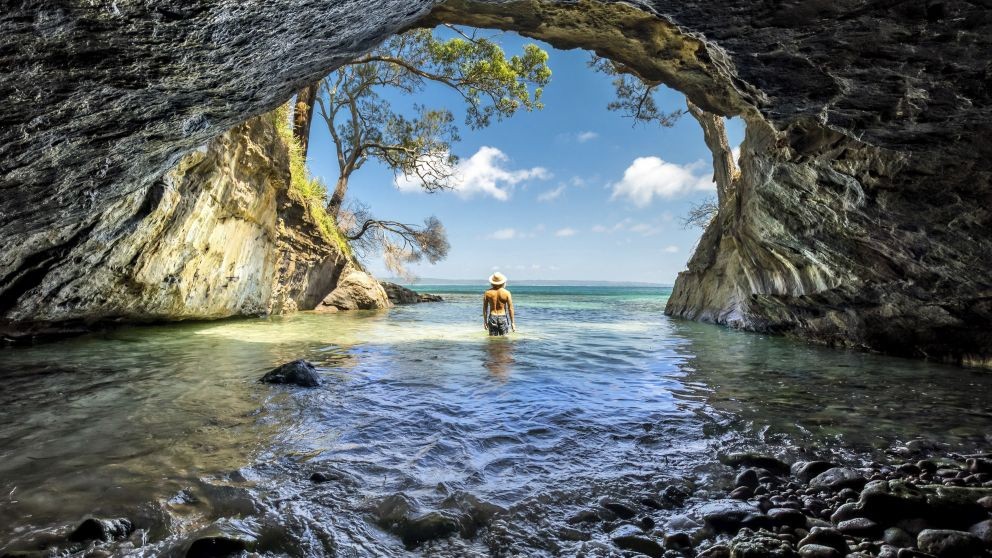 Man enjoying the sun from a sea cave in Jervis Bay, South Coast - Credit: Jordan Robins