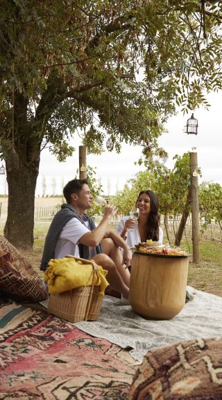 Couple enjoying a tailored picnic package at Heifer Station in Orange, Country NSW