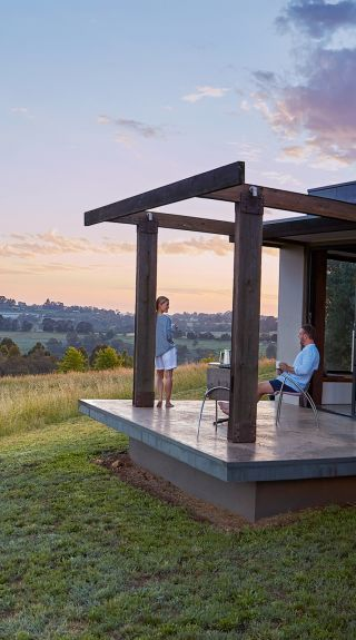 Couple enjoying the views in their country accommodation at Borrodell Vineyard in Canobolas, Orange Area in the Country NSW