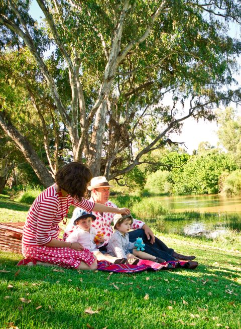 Young family picnicking by Lachlan River