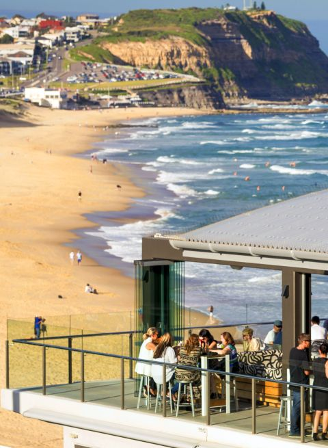 People enjoying food and views at the Surfhouse Restaurant in Newcastle