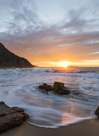 Sun rising over Zenith Beach, Shoal Bay
