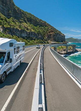 Campervan taking the scenic route over Sea Cliff Bridge, Clifton