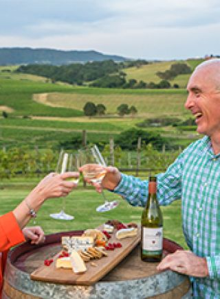 Couple enjoying wine and cheese at Crooked River Winery in the Kiama Area