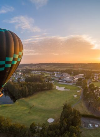 Hot air balloon over golf course in Lovedale, Hunter Valley