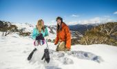 Friends building a snowman at Thredbo in the NSW Snowy Mountains