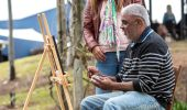 Local Aboriginal artist Les Ahoy working on his artwork on the WUPA@Wanuruah Art Trail at Hunter Valley Resort
