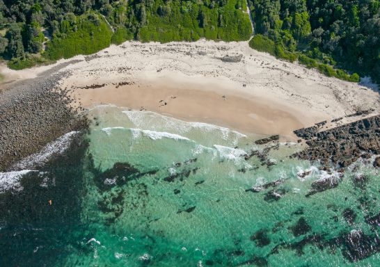 Coastal aerial of Pebbly Beach and Bicentennial Walk in Forster, North Coast