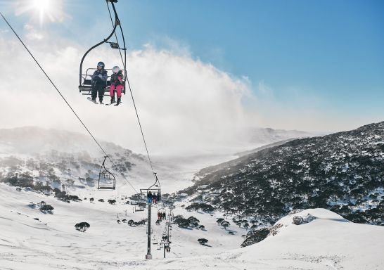 Skiiers riding the chair lifts at Charlotte Pass Ski Resort in the Snowy Mountains.