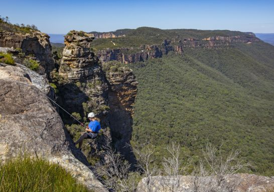 Woman abseiling at Cahills Lookout, Katoomba in the Blue Mountains