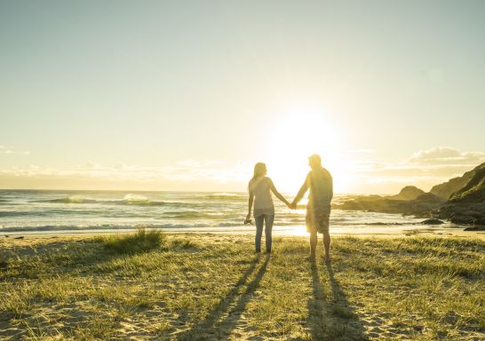 Couple enjoying a morning walk at Potato Point in the Eurobodalla region of NSW.