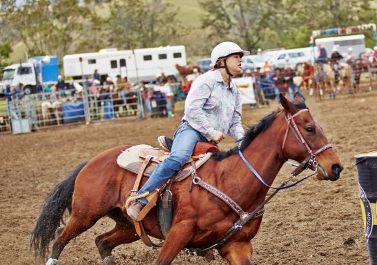 Woman riding a horse at The Annual Gresford Rodeo & Campdraft in Dungog,  Barrington Tops