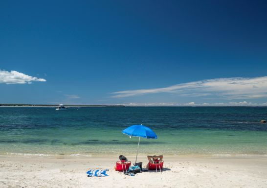 Couple enjoying a day ay Huskisson Beach, Jervis Bay