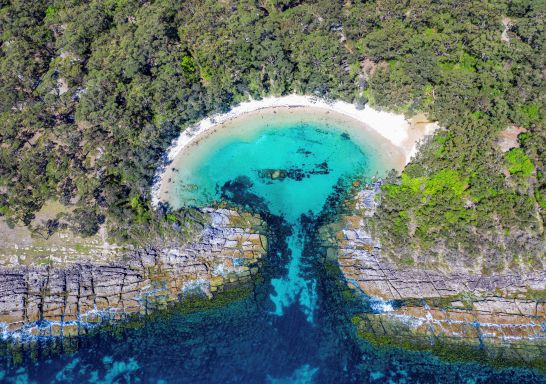 Aerial overlooking Honeymoon Bay - Jervis Bay - South Coast